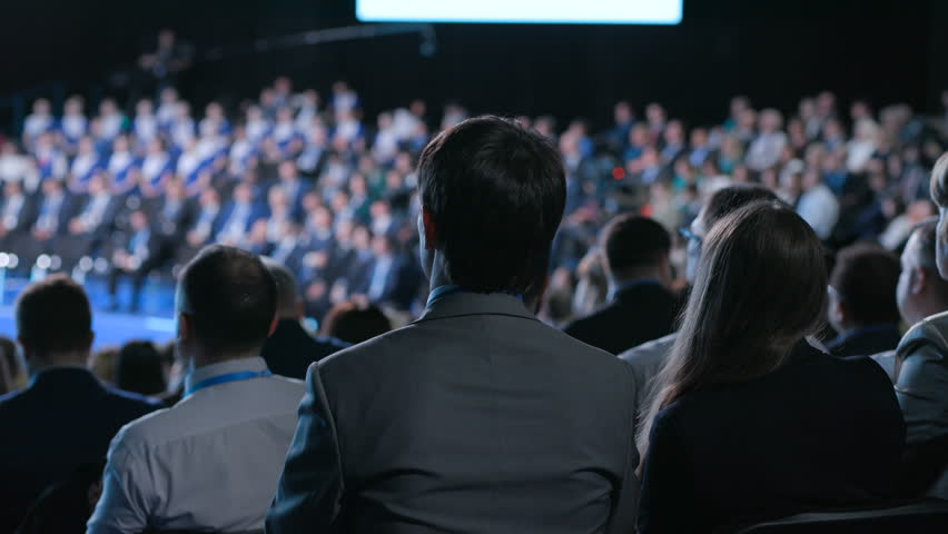 Crowd at banking congress for development idea of sales or leadership. Information for cooperation solution of entrepreneur. Full row of seats or chairs in modern large place for listener or spectator | Shutterstock HD Video #1014553223