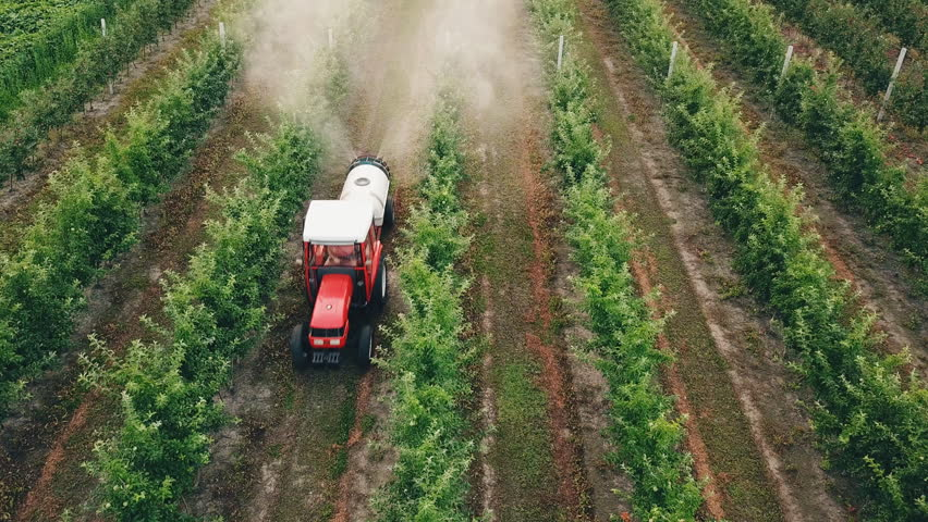 apple tree spraying with a tractor Royalty-Free Stock Footage #1014557234