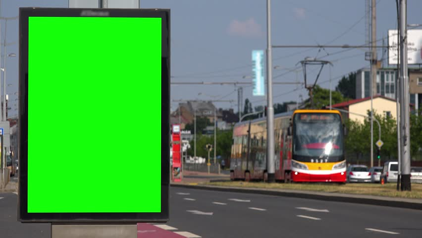 A small billboard with a green screen by a road in an urban area | Shutterstock HD Video #1014562394