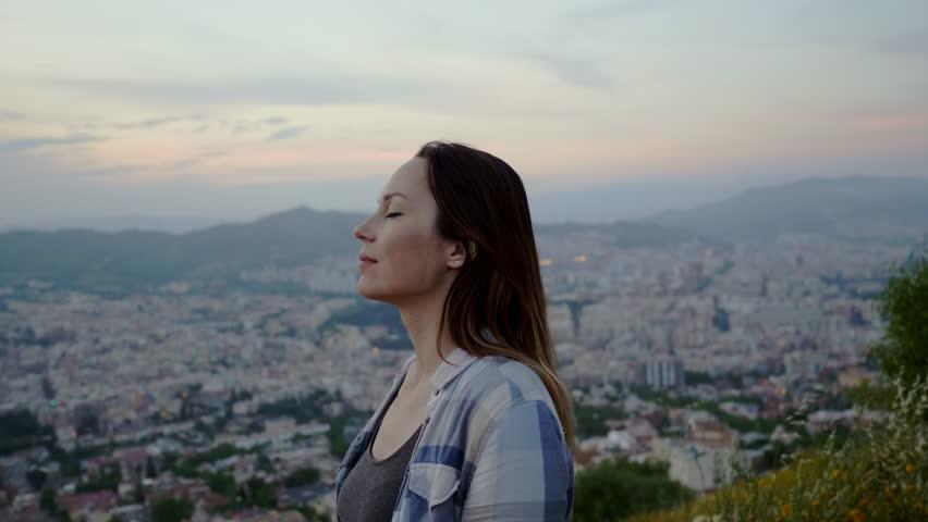 Beautiful woman enjoying Barcelona city view from Bunkers del Carmel, Spain   Shutterstock HD Video #1014566588