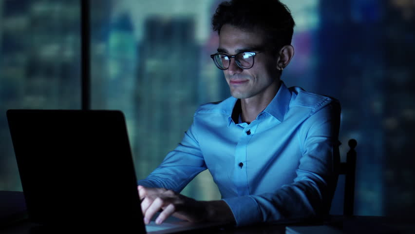 Man Using Computer At Night, Internet Addiction, Social Networks, Gaming, Searching the Internet All Night | Shutterstock HD Video #1014602816