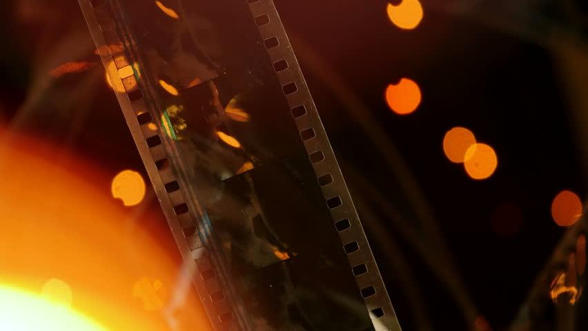 Film On Background Of Flashing Lights | Shutterstock HD Video #1014603101