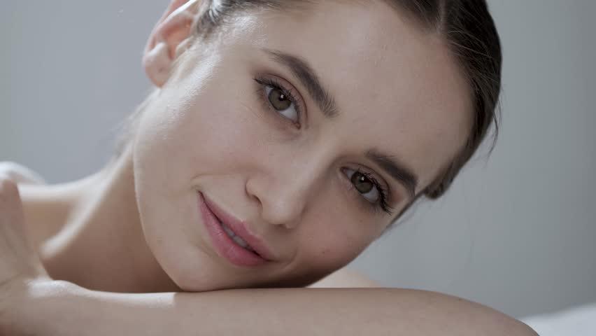 Natural Beauty. Beautiful Woman With Makeup Smiling Closeup