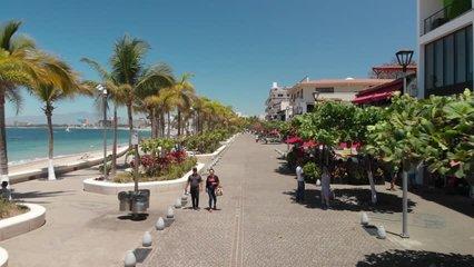 Aerial clip flying over Puerto Vallarta seaside promenade, a 12 mile long walking esplanade in Puerto Vallarta, Mexico.