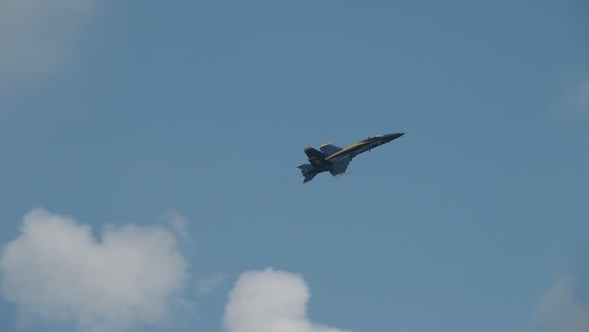 Blue Angel flight doing a barrel roll