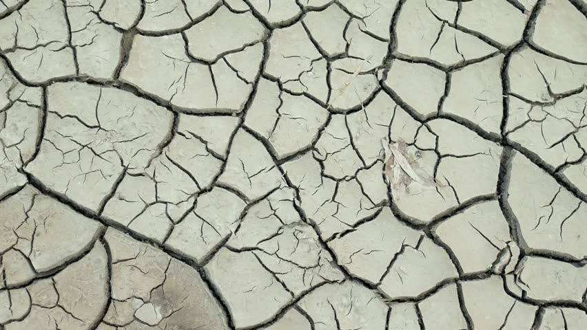 Dry lake with natural texture of cracked clay. Death Valley field | Shutterstock HD Video #1014687842