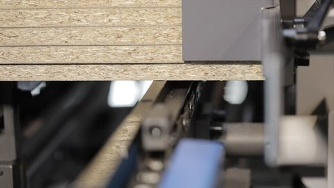 Modern woodworking with CNC. Work mechanisms of industrial woodworking machine tools. Close-up, macro.
