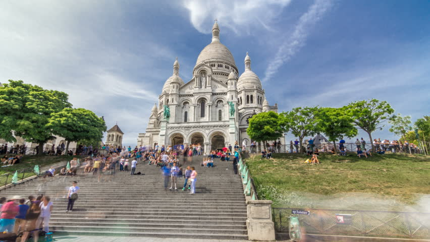 Tourists near the Basilica of the Sacred Heart of Paris (Sacra-Coeur) is a Roman Catholic church timelapse hyperlapse. Located at the summit of the butte Montmartre. Paris, France. | Shutterstock HD Video #1014705989