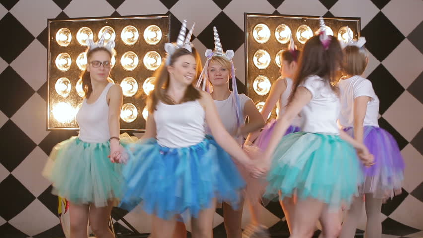 Happy funny lifestule girl's in colorful skirts laughing, having fun, celebrating hen day or night out party