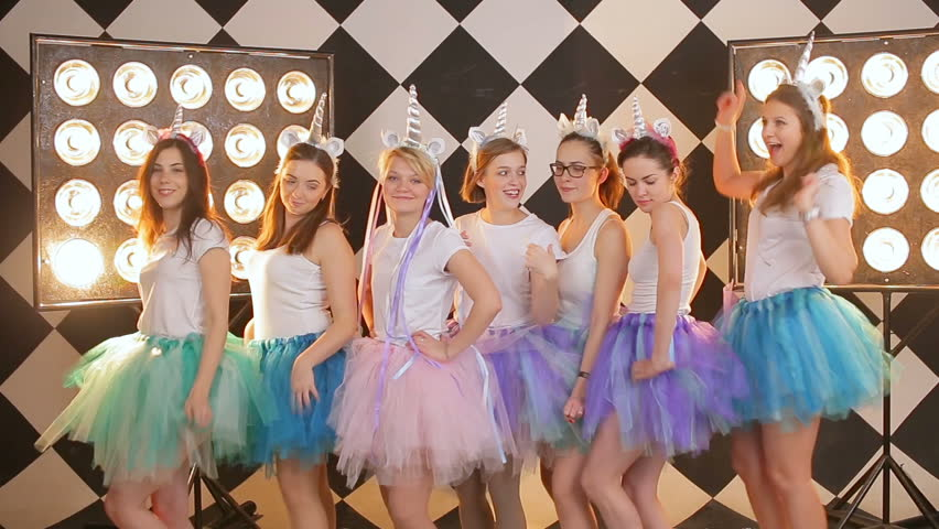 a merry group of young girls celebrate hen party before wedding festive video at the background of highlight's studio light equipment