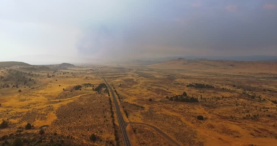 Drone flies over the national park in the USA at sunset. Fire and dust in the sky, because of California fires. Atmospheric landscapes. | Shutterstock HD Video #1014721202