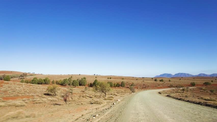 Driving on dirt road in Ikara-Flinders Ranges National Park in South Australia | Shutterstock HD Video #1014722405