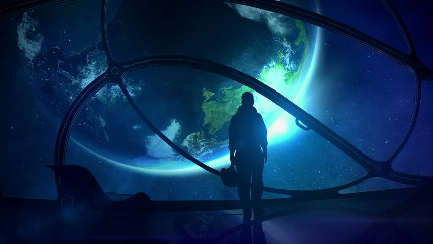The astronaut looks at the globe   Shutterstock HD Video #1014731765