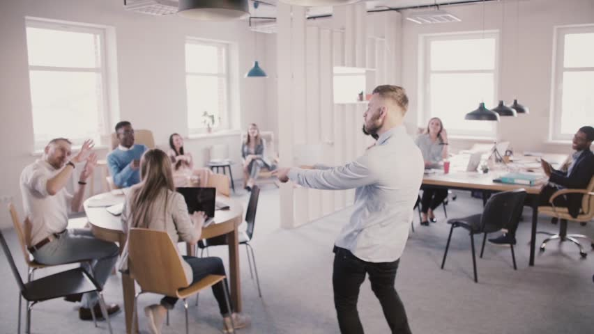 Excited man entering multiethnic office, doing funny celebration dance to share success with colleagues slow motion. | Shutterstock HD Video #1014741416