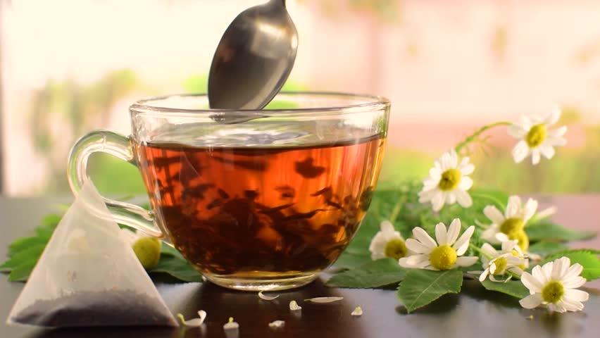 Spoon the tea chamomile tea. Chamomile flowers on the table. Royalty-Free Stock Footage #1014743744