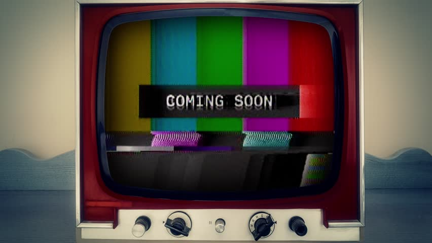 A retro vintage TV showing a noisy signal of SMPTE color bars (a television screen test pattern) with the text Coming Soon. Analog capture, intentional heavy distortion fx.  | Shutterstock HD Video #1014747686