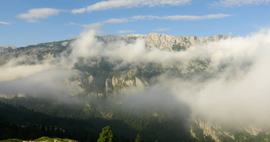 """Sunny day with clouds, shot from above, in high mountains, no people, Bosnia and Herzegovina, Republic of Srpska, National Park """"Sutjeska"""" 