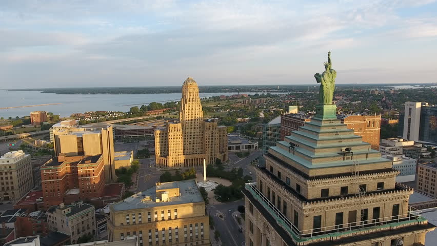 Statue of Liberty in Buffalo New York Immigration and Freedom. Aerial of Downtown Buffalo New York at Sunrise. Flying over the city of Buffalo NY in first light of the morning. Urban city scene.