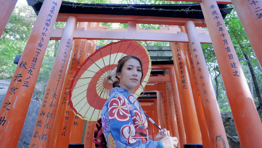 Asian women in traditional japanese kimonos is smiling and happiness at Fushimi Inari Shrine in Kyoto, Japan. | Shutterstock HD Video #1014802559