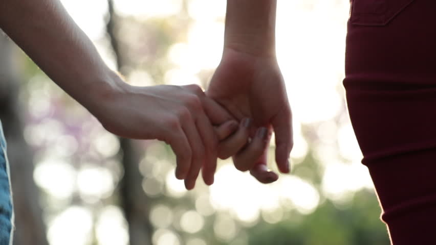 Close-up of holding hands by finger #1014803621