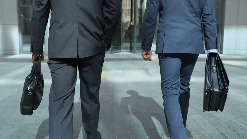 Business people going to office center, communicating, beginning of work day   Shutterstock HD Video #1014832555