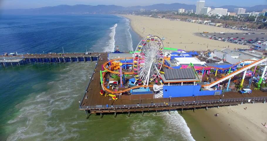 Aerial  view of Santa Monica Beach and famous iconic Pier landmark, Los Angeles, California, 4K