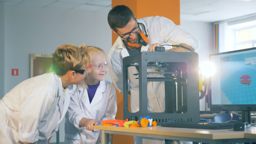 Modern education concept. Chikdren study technology with a engineer in a school lab. #1014866587