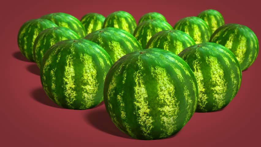 Ripe whole watermelons  on red background close-up | Shutterstock HD Video #1014879079