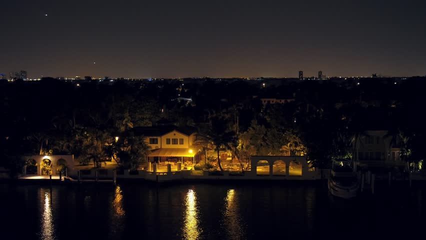 Aerial Miami luxury mansion at night