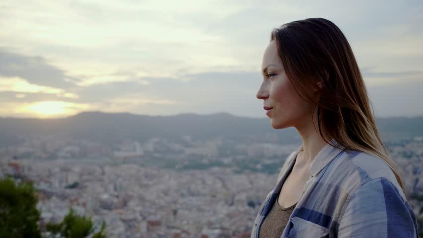 Beautiful woman enjoying Barcelona city view from Bunkers del Carmel, Spain   Shutterstock HD Video #1014885142