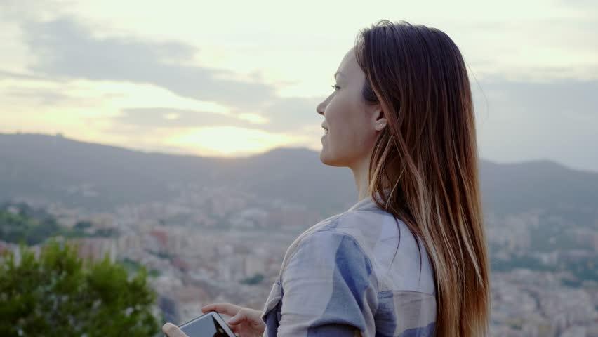 Beautiful woman enjoying Barcelona city view from Bunkers del Carmel, Spain | Shutterstock HD Video #1014885154