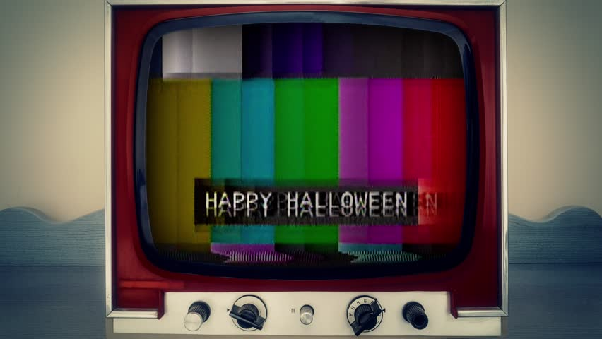 A retro vintage TV showing a noisy signal of SMPTE color bars (a television screen test pattern) with the text Happy Halloween. Analog capture, intentional heavy distortion fx.  | Shutterstock HD Video #1014886786