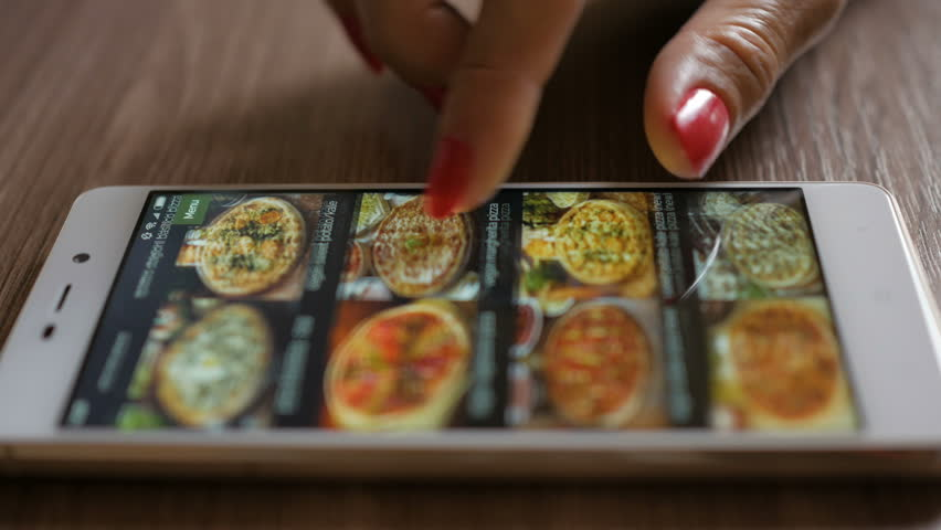 Woman Orders Pizza Using Online Delivery Service With Smartphone. Close Up. 4K UHD.