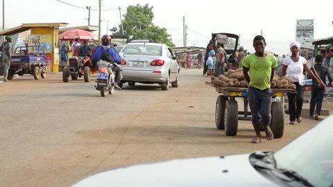 Yeji, Ghana - 2018: Women selling in a busy street market in a small African town.