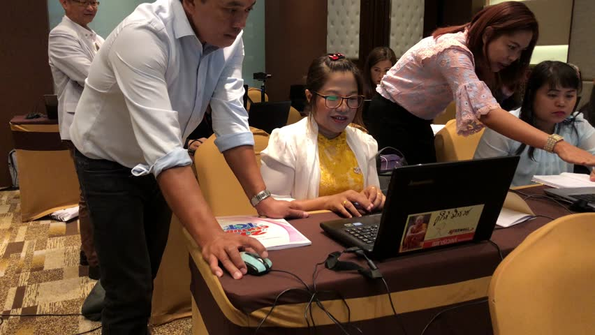 NAKHONRATCHASIMA, THAILAND - AUG 12 : Training school teachers with How to Make English electronic Book for Students in Thailand content on August 2018. | Shutterstock HD Video #1014909394