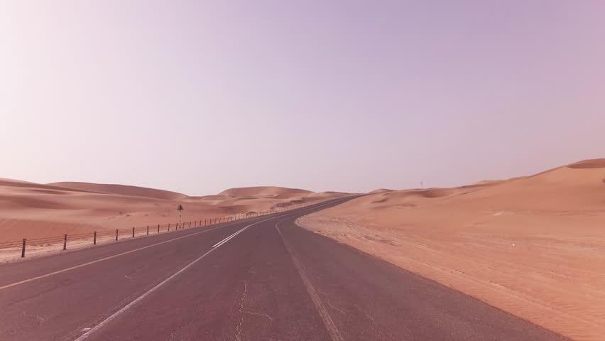 New road from Oasis Liwa to the Moreeb Dune in Rub al Khali desert stock footage video | Shutterstock HD Video #1014920710