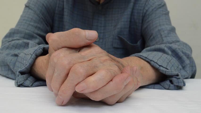 Elderly woman hands on a table | Shutterstock HD Video #1014935086