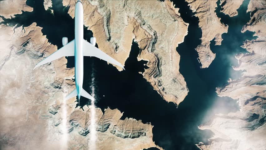 Aerial video of Grand Canyon. Flying over the mountains. Top view of white airplane flying above Grand Canyon.