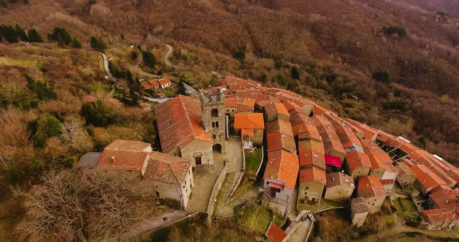 Aerial, beautiful little hamlet with a church on the hill in Tuscany, Italy | Shutterstock HD Video #1015040293