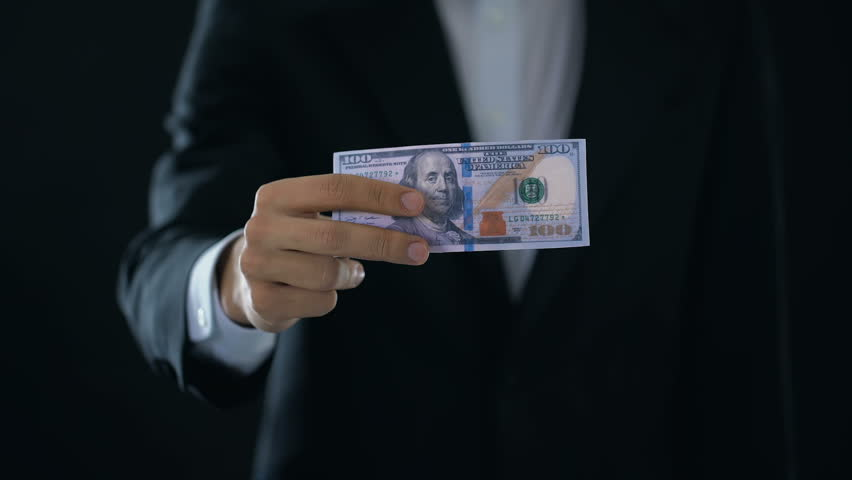 Male hands crumpling dollar banknote and throwing out, income decline, crisis | Shutterstock HD Video #1015043947