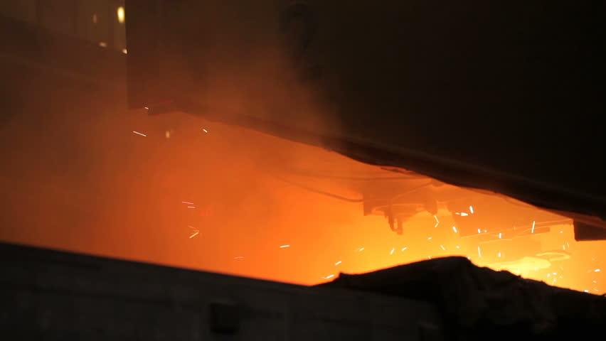Steel billets at torch cutting | Shutterstock HD Video #1015057720
