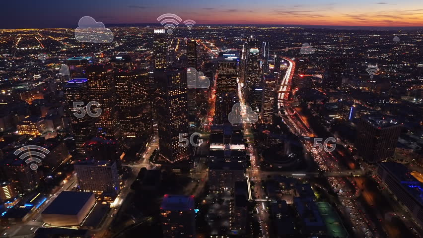 Aerial city connected through 5G. Wireless network, mobile technology concept, data communication, cloud computing, artificial intelligence, internet of things. Los Angeles skyline. Futuristic city.