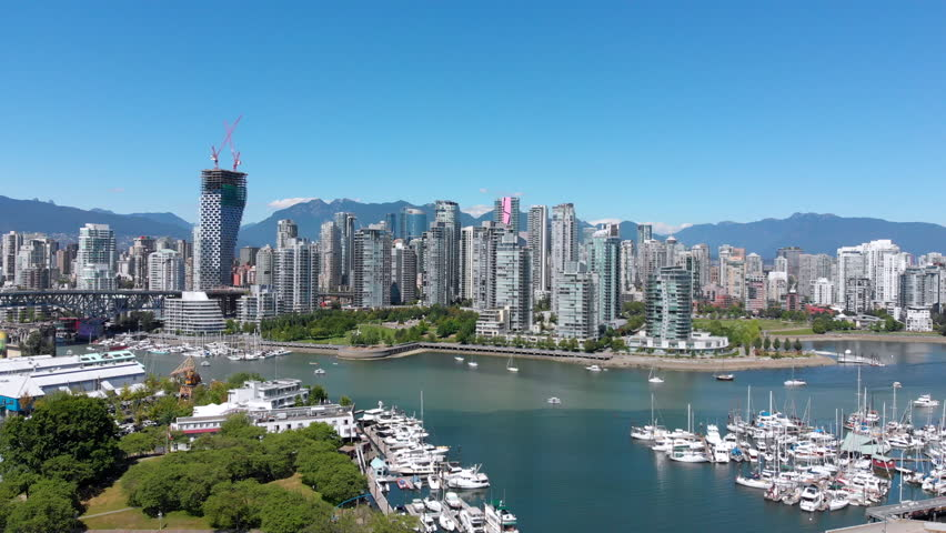 Vancouver, BC, Canada, aerial view of False Creek including Granville Bridge, Spruce Harbour Marina and Downtown Vancouver skyline during Summer, daytime.