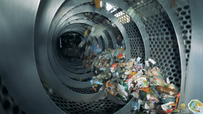 Trash is revolving inside an industrial recycling machine. Waste recycling equipment.   Shutterstock HD Video #1015111579