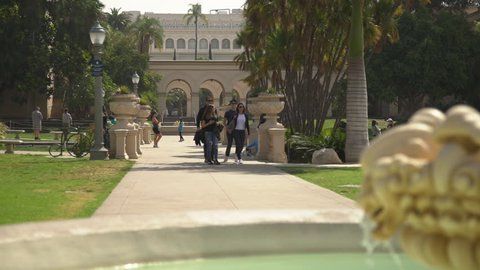 San Diego, United States - June, 2017: People walking near a fountain in Balboa Park.