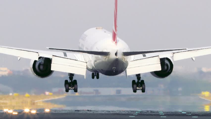 Airplane Is Landing On The Airport .  Passenger airplane landing. Turkey Istanbul