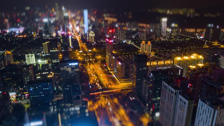 Night time shenzhen city downtown traffic street aerial panorama 4k tilt shift timelapse china