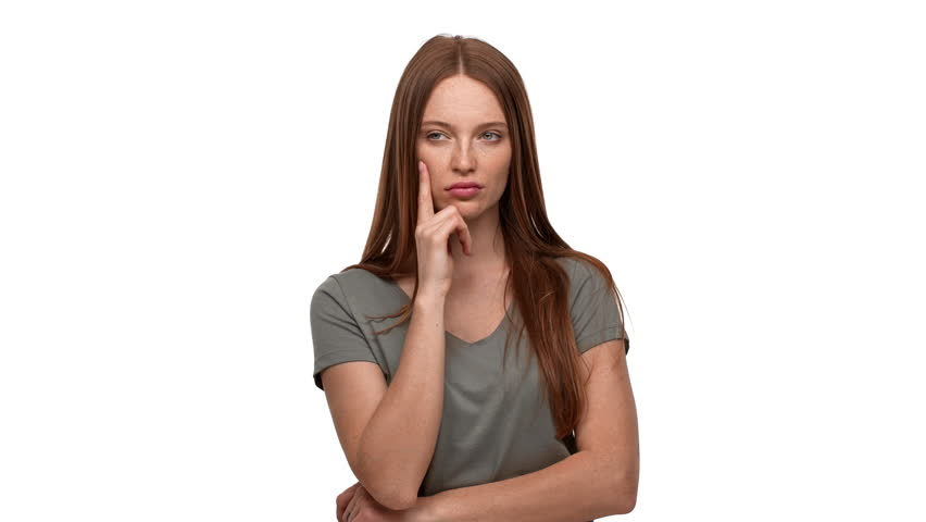 Portrait of ginger woman 20s touching chin and thinking about important things or doubting, isolated over white background. Concept of emotions | Shutterstock HD Video #1015181065