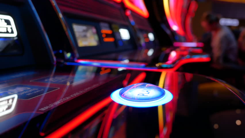 Motion of woman pressing play button on slot machine inside Casino with 4k resolution