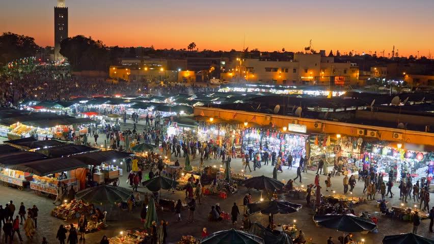 Jamaa el Fna (Jemaa el-Fnaa) in the evening. Marrakesh, Morocco. Zoom out shot
